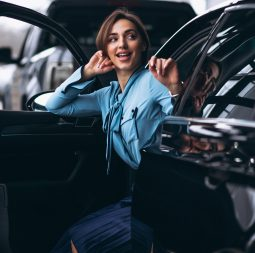 Woman happy buying a car