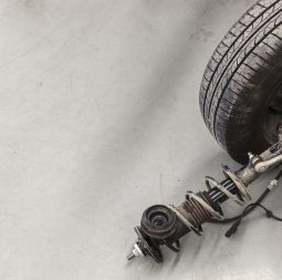 closeup wheels and shock absorbers with repair the suspension on the car. soft-focus and over light